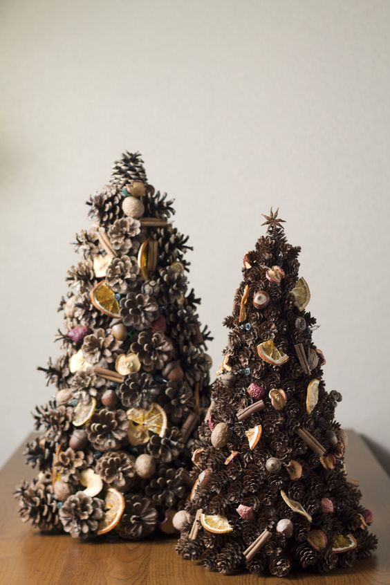 pinecone Christmas tree decorated with cinnamon sticks, nuts, citrus and dried fruits for a rustic feel