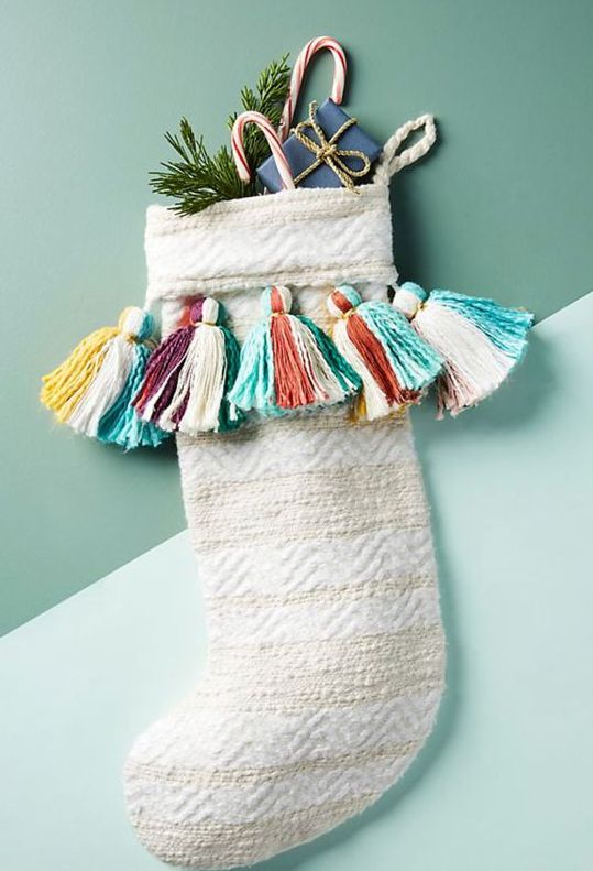 your neutral stockings can be spruced up easily with some large and colorful tassels, make and attach them