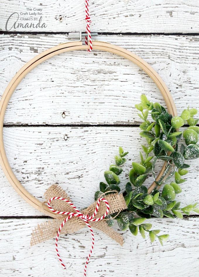 DIY winter embroidery hoop wreath with fake succulents (via craftsbyamanda.com)