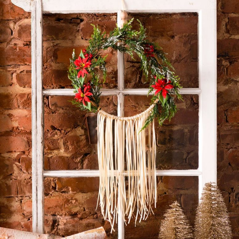 DIY embroidery hoop and fake greenery and fringe wreath (via www.brit.co)