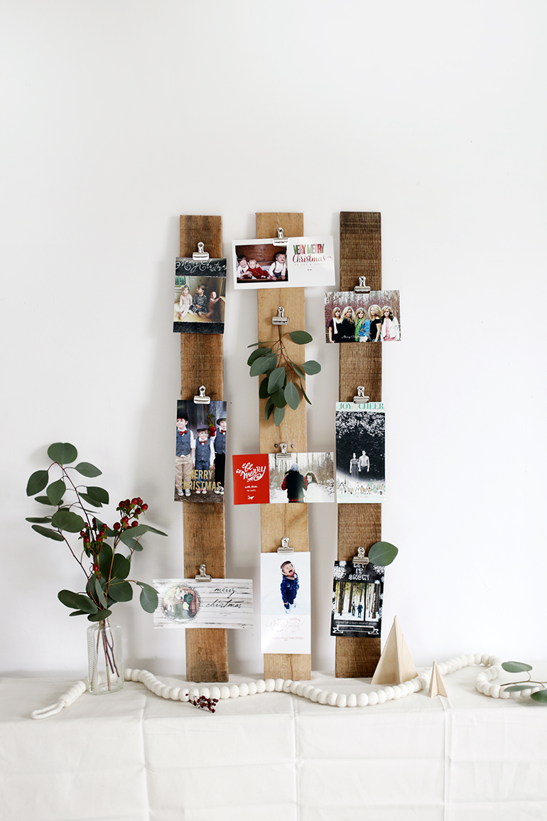 DIY wooden plank Christmas card display (via themerrythought.com)