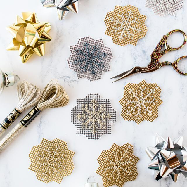 DIY sparkly metallic cross stitch snowflakes (via stitchedmodern.com)
