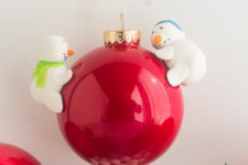 DIY red Christmas ornament with snowmen attached