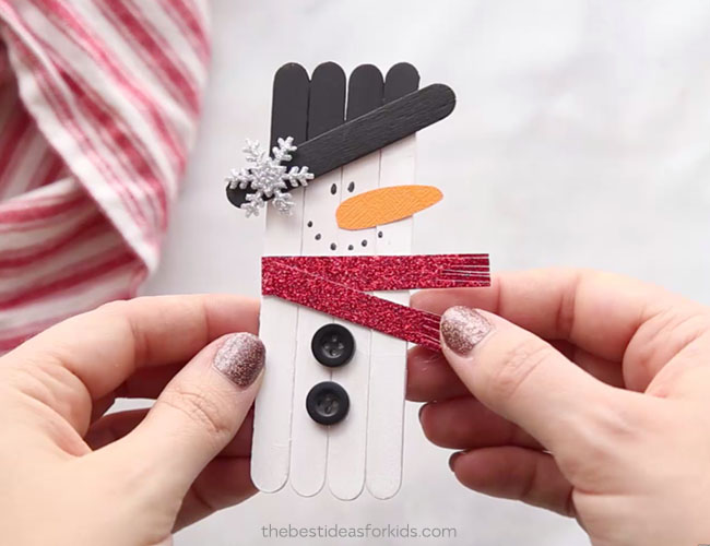 DIY snowman popsicle stick Christmas ornament (via www.thebestideasforkids.com)