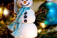 DIY snowman Christmas ornament with a beanie and scarf