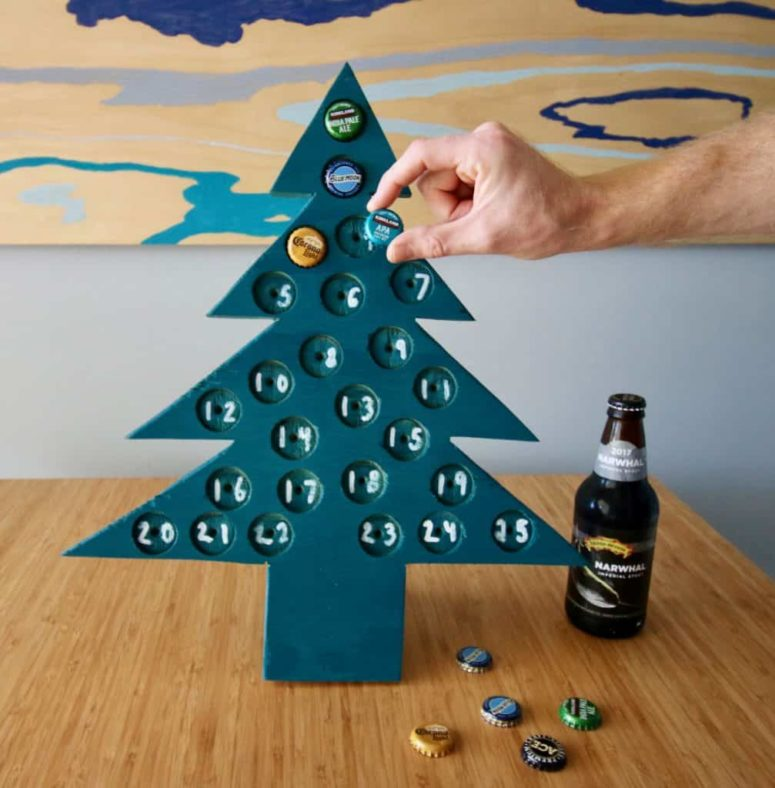 DIY tree-shaped advent calendar with beer bottle caps (via www.charlestoncrafted.com)