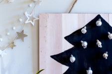 DIY black balsa wood advent calendar with silver ornaments