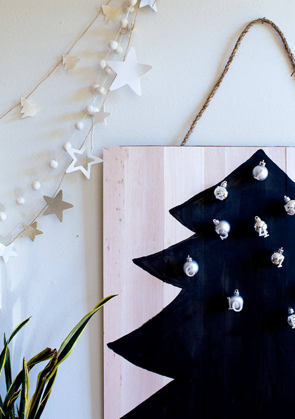 DIY black balsa wood advent calendar with silver ornaments
