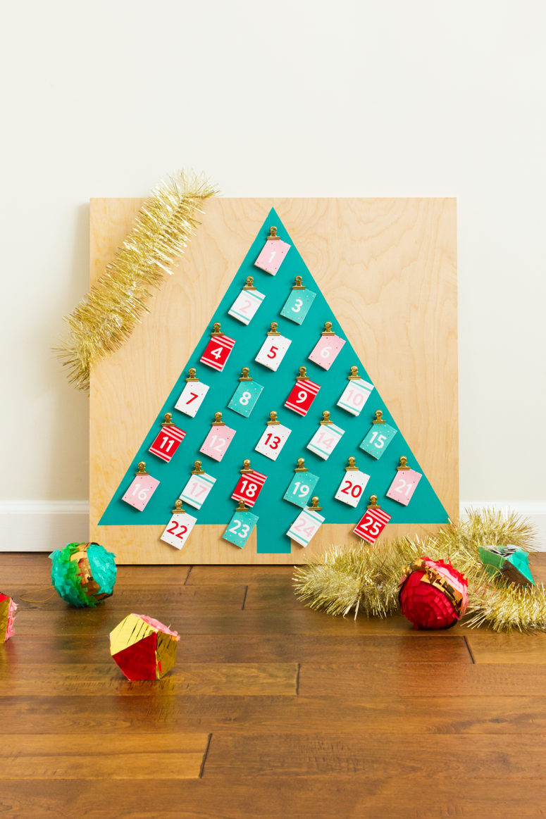 DIY colorful Christmas tre-shaped calendar with gold clips (via sarahhearts.com)