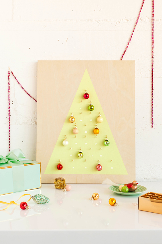 DIY modern Christmas calendar with colorful ornaments (via www.minted.com)