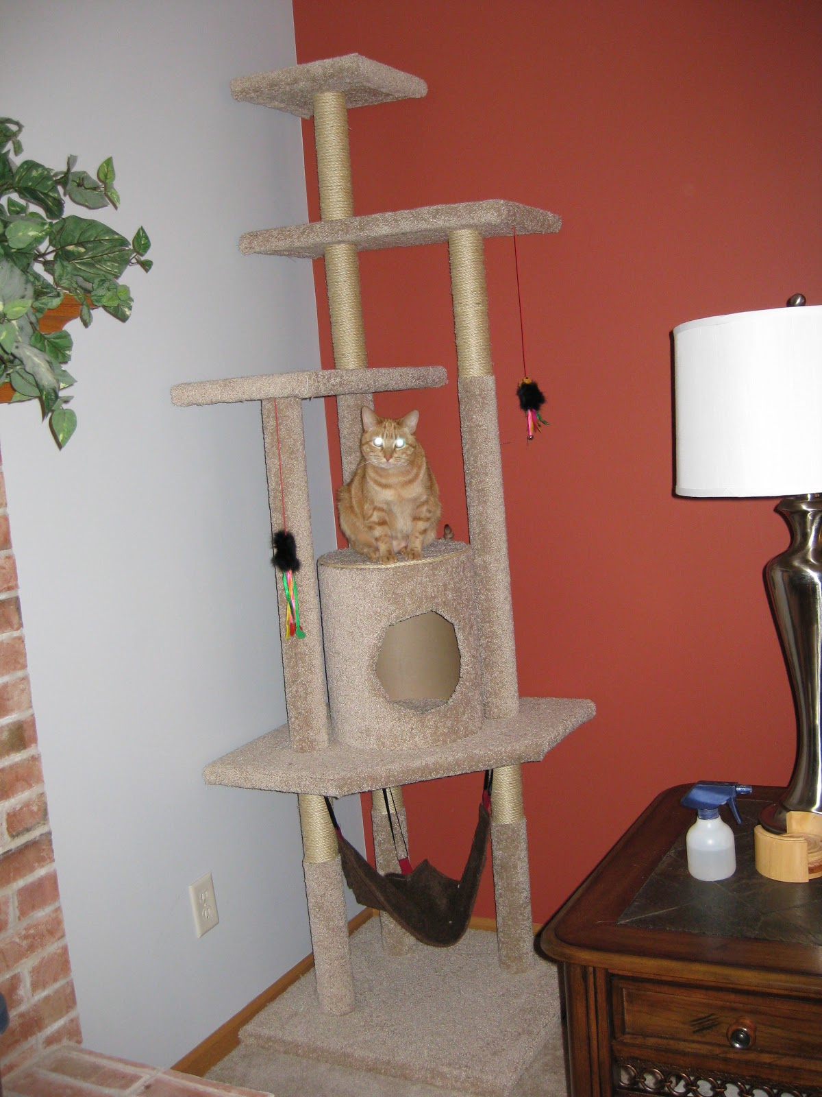 DIY carpet and jute covered cat tree with a house