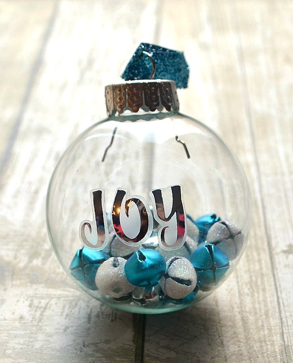 DIY clear Christmas ornament filled with jingle bells (via www.amylattacreations.com)