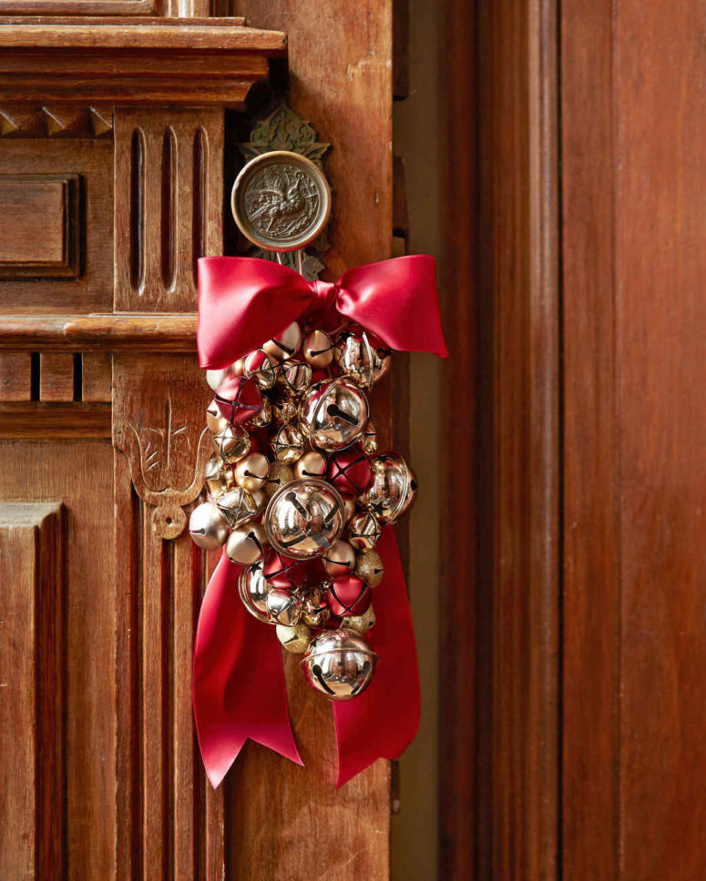 DIY jingle bell cluster ornament with a large red bow (via www.marthastewart.com)