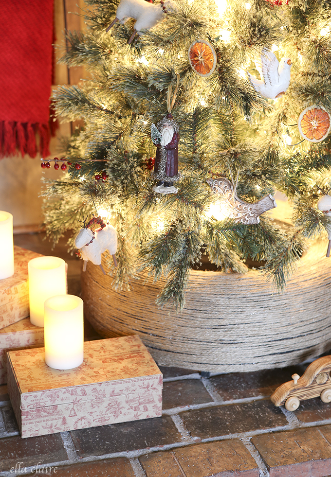 DIY Christmas tree stand of a jute wrapped tire (via www.ellaclaireinspired.com)