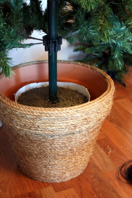 DIY Christmas tree stand of two planters, soil and jute (via sweetsomethingdesign.blogspot.com)