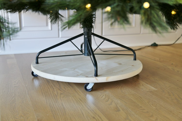 DIY mobile tree stand of wood and on casters (via www.sandandsisal.com)