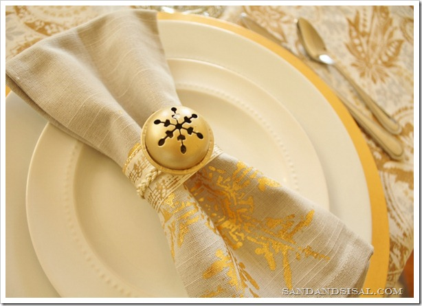 DIY large jingle bell napkin rings for Christmas table settings (via www.sandandsisal.com)