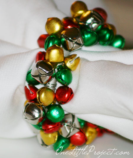 DIY colorful jingle bell napkin rings for Christmas (via onelittleproject.com)