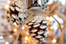 DIY snowy pinecone Christmas ornaments with jingle bells