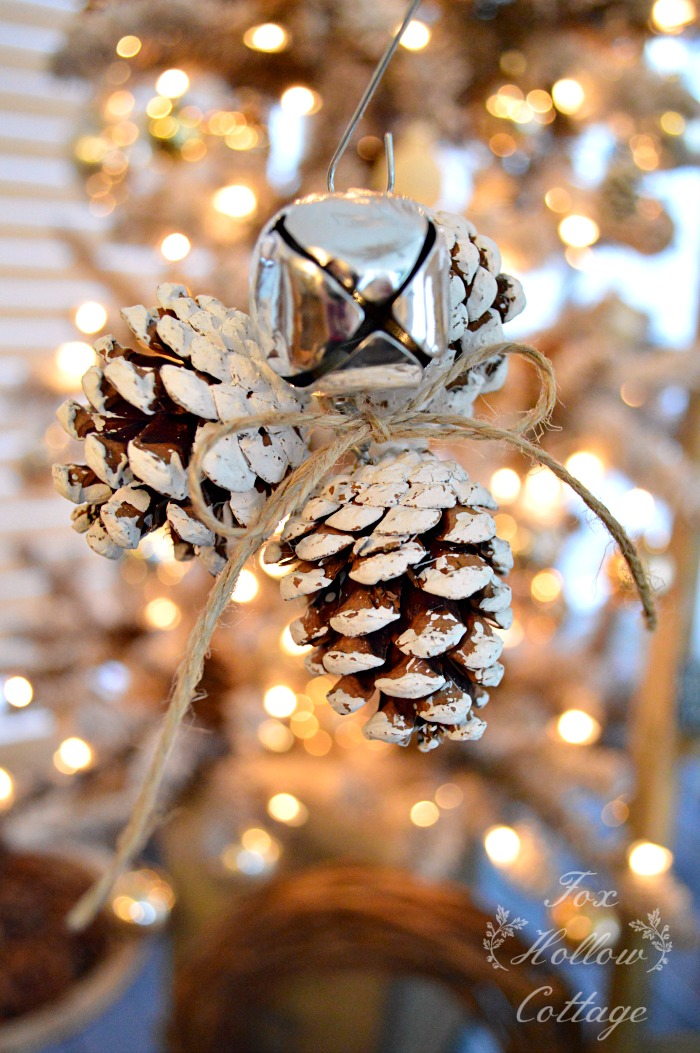 DIY snowy pinecone Christmas ornaments with jingle bells (via www.bystephanielynn.com)