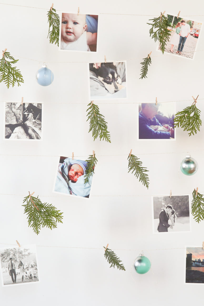 DIY hanging picture wall with ornaments and greenery (via www.forthemakers.com)