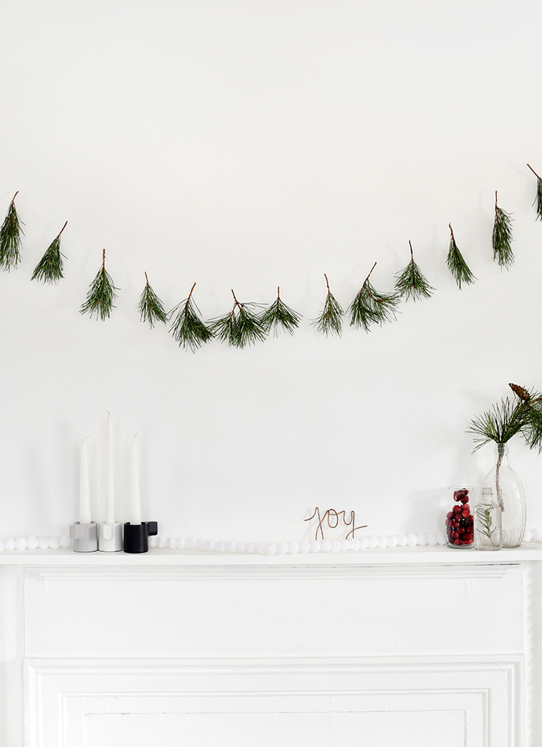 DIY simple pine sprig garland for Christmas (via themerrythought.com)