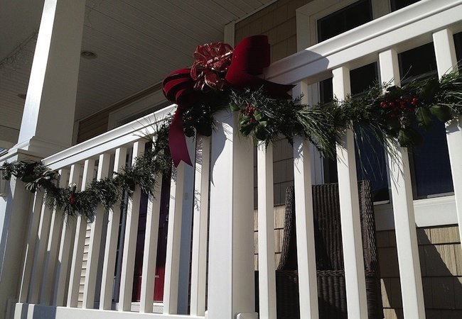 DIY fresh greenery Christmas garland for outdoor decor (via www.bobvila.com)