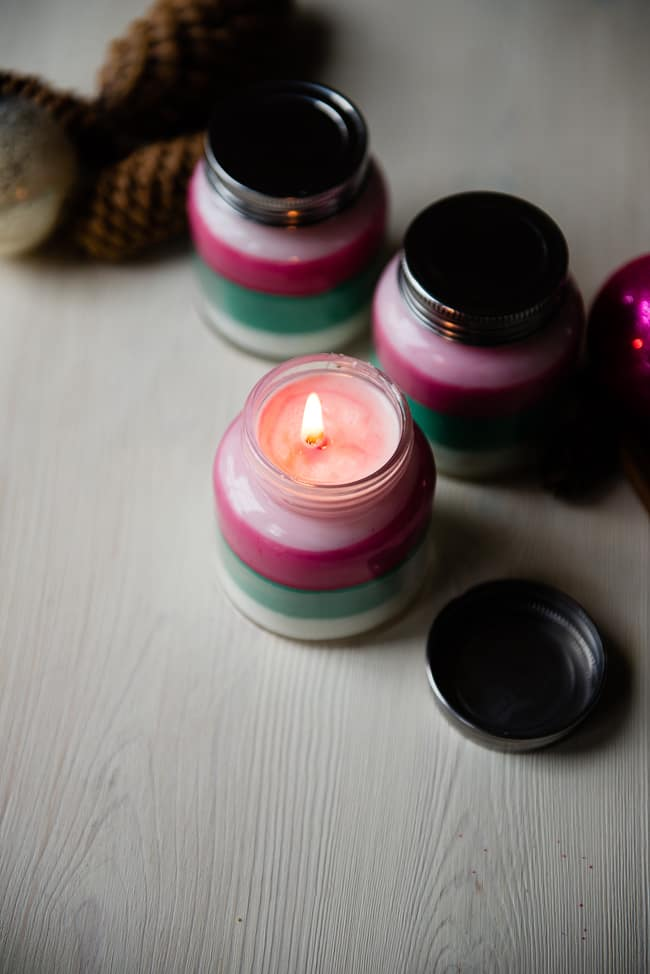 DIY colorful layered and scented Christmas candles (via helloglow.co)