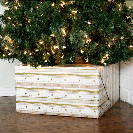DIY Christmas tree box decorated with gift wrapping paper (via www.dreamalittlebigger.com)
