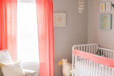 02 a coastal chic themed nursery spruced up with coral curtains, an ombre coral pillow and an accent on the bed