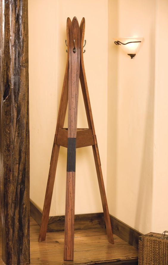 a coat rack made of old skis is a great idea to upcycle old skis and get a useful furniture piece