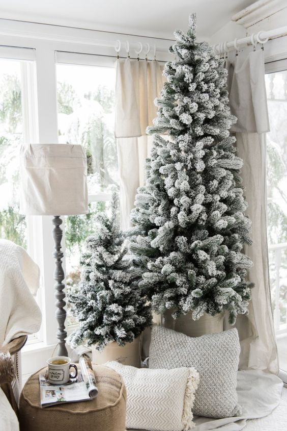 a duo of non-decorated flocked Christmas trees is a great idea for a modern or farmhouse space