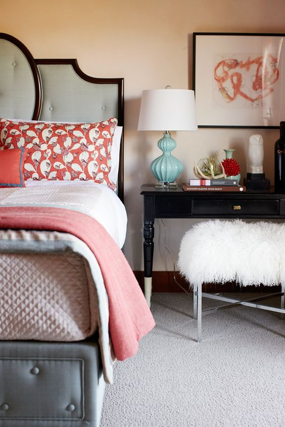 a coral printed pillow and a matching blanket is a cool and budget-friendly way to spruce up your space