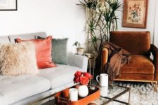 04 a coral velvet pillow and a floral arrangement in coral will add a trendy feel to the space