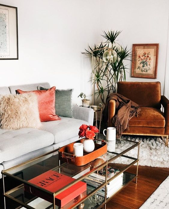 a coral velvet pillow and a floral arrangement in coral will add a trendy feel to the space
