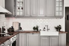 grey kitchen with wooden countertops