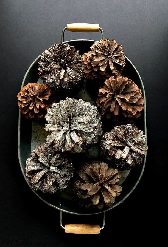 a modern tin tray with handles and glittered and usual pinecones will be a nice decoration for your kitchen