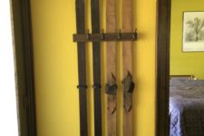 05 a simple wall-mounted ski coat rack is a great and fast DIY for a chalet or a farmhouse