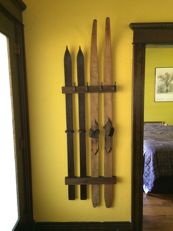 a simple wall-mounted ski coat rack is a great and fast DIY for a chalet or a farmhouse