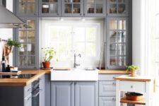 06 a grey kitchen with wooden countertops and whites and off-whites looks traditional meets modern