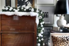 06 an evergreen Christmas garland with white and silver ornaments integrated can be placed on a dresser