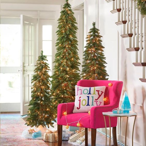 a trio of Christmas trees with lights will make your entryway special