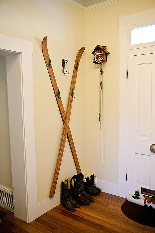 skis as a coat rack for your entryway is a cool winter idea, add vintage charm to your space