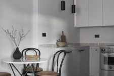 08 a minimalist dove grey kitchen with sleek cabinets, a grey marble countertop and minimalist lamps