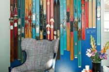 09 a cozy nook decorated with colorful vintage skis is a very cool idea for sport lovers or for a winter home
