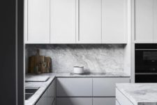 09 a minimalist kitchen with sleek grey cabinets and a grey marble backsplash and countertops