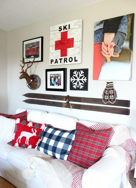 a gallery wall with vintage skis over the sofa feels so wintry and so sporty at the same time