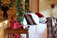 10 decorate your bed poles with an evergreen garland with lights and pinecones to give it a super welcoming holiday look