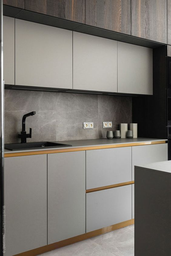 a minimalist light grey kitchen with sleek cabinets anad no knobs, grey marble tiles and a matte faucet