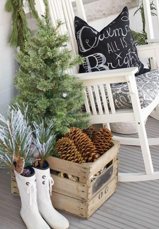 a vintage crate filled with large pinecones is a great outdoor decor idea